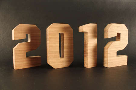 2012 text from wood numbers Holz black Background