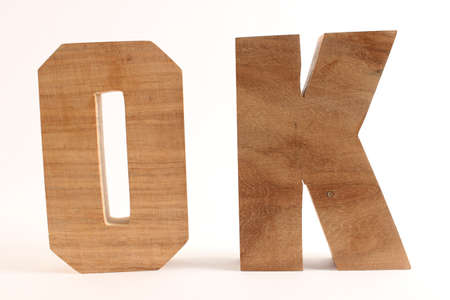 OK text from wood letters Buchstaben white Background straight