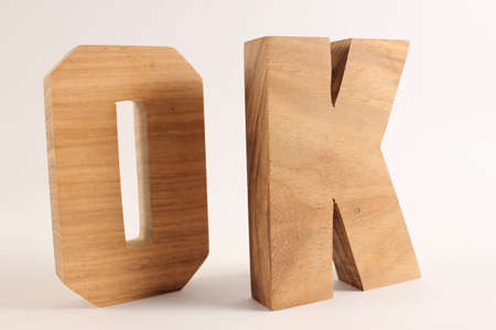 naturholz: OK text from wood letters Holz Buchstaben white Background Stock Photo