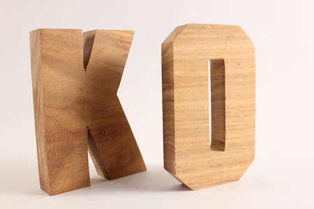 KO text from wood letters Buchstaben white Background