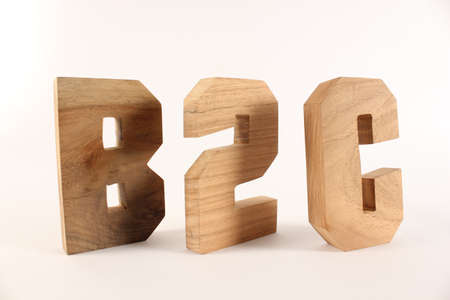 holzbuchstaben: B2C text from wood letters Holz Buchstaben white Background Stock Photo