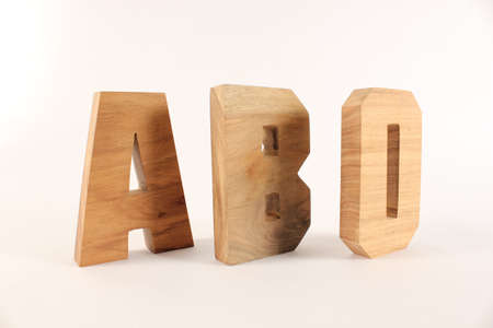 naturholz: ABO text from wood letters Holz Buchstaben white Background