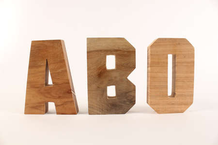 typ: ABO text from wood letters Holz Buchstaben white Background straight