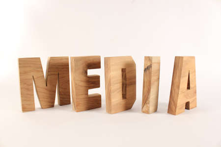 naturholz: MEDIA text from wood letters Buchstaben white Background Stock Photo