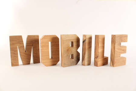 naturholz: MOBILE text from wood letters Holz Buchstaben white Background Stock Photo