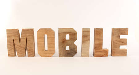 naturholz: MOBILE text from wood letters Holz Buchstaben white Background straight