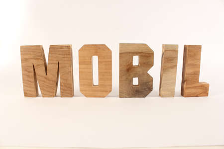 buchstabe: MOBIL German text from wood letters Buchstaben white Background straight