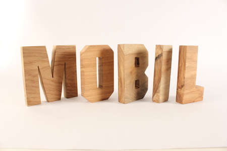 buchstaben: MOBIL text from wood letters Holz Buchstaben white Background Stock Photo