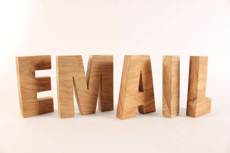 naturholz: Email text from wood letters Holz Buchstaben white Background Stock Photo