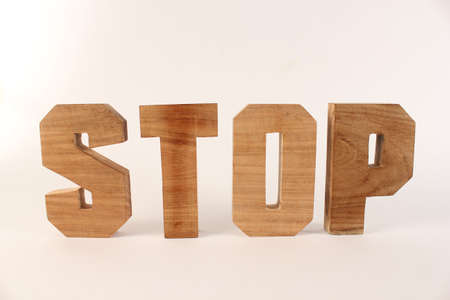 buchstaben: Stop text from wood letters Holz Buchstaben white Background straight Stock Photo