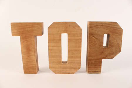 naturholz: Top text from wood letters Holz Buchstaben white Background straight Stock Photo