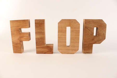 lettre: Flop text from wood letters Holz Buchstaben white Background straight