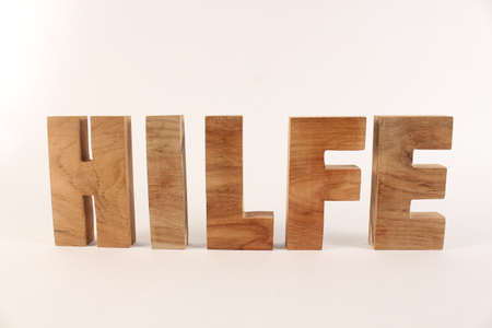 Hilfe text from wood letters Holz Buchstaben white Background straight