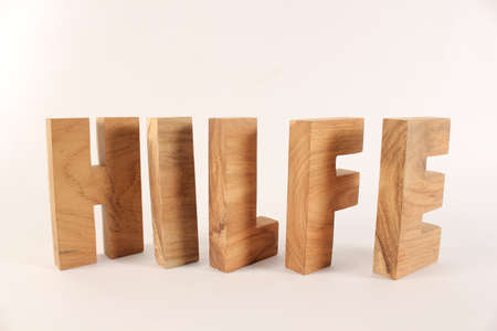 naturholz: Hilfe text from wood letters Holz Buchstaben white Background
