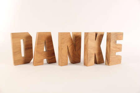 naturholz: Danke text from wood letters Holz Buchstaben white Background