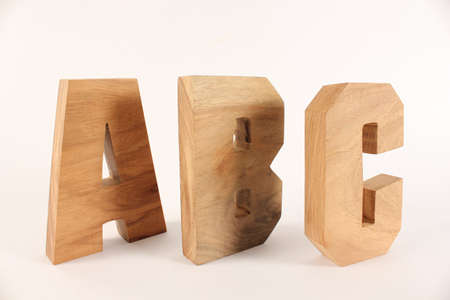 naturholz: ABC text from wood letters Holz Buchstaben white Background