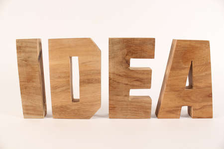 naturholz: Idea text from wood letters Holz Buchstaben white Background straight Stock Photo