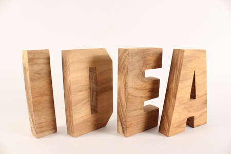 naturholz: Idea text from wood letters Holz Buchstaben white Background
