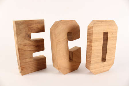lettre: ECO text from wood letters Holz Buchstaben white Background Stock Photo