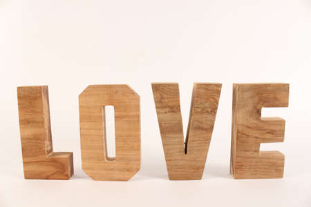 naturholz: Love text from wood letters Holz Buchstaben white Background straight