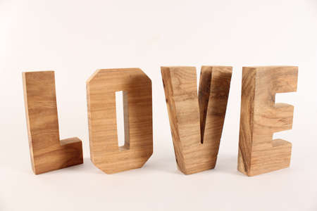 naturholz: Love text from wood letters Holz Buchstaben white Background