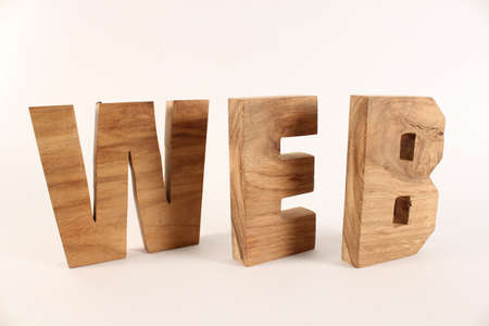 naturholz: WEB text from wood letters Holz Buchstaben white Background Stock Photo
