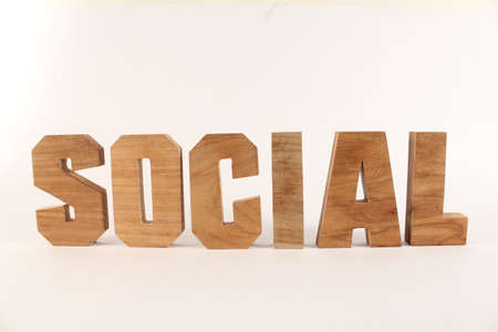buchstaben: Social text from wood letters Holz Buchstaben white Background straight Stock Photo