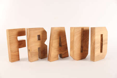 buchstabe: Fraud text from wood letters Holz Buchstaben white Background Stock Photo