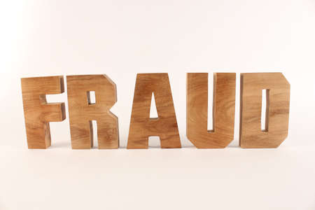 buchstaben: Fraud text from wood letters Holz Buchstaben white Background straight Stock Photo