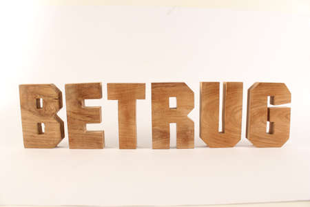 naturholz: Betrug text from wood letters Holz Buchstaben white Background straight