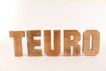 naturholz: Teuro text from wood letters Holz Buchstaben white Background straight