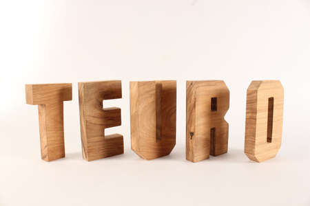 naturholz: Teuro text from wood letters Holz Buchstaben white Background Stock Photo
