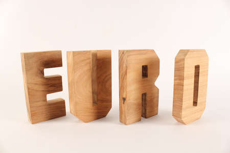 lettre: Euro text from wood letters Holz Buchstaben white Background