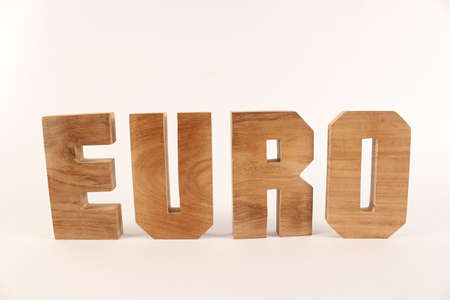 buchstaben: Euro text from wood letters Holz Buchstaben white Background straight Stock Photo