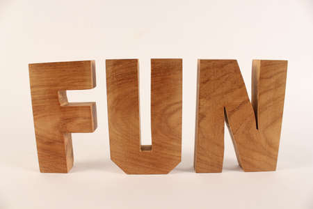 Fun text from wood letters Holz Buchstaben white Background straight