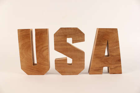 USA text from wood letters Holz Buchstaben white Background straight Stock Photo