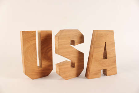 naturholz: USA text from wood letters Holz Buchstaben white Background