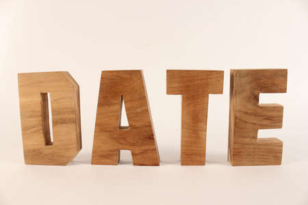 Date text from wood letters Holz Buchstaben white Background straight