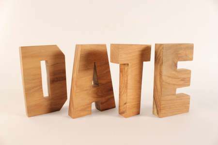 naturholz: Date text from wood letters Holz Buchstaben white Background Stock Photo