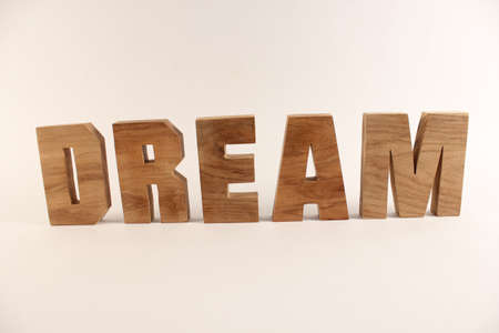 naturholz: Dream text from wood letters Holz Buchstaben white Background straight