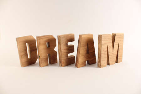 naturholz: Dream text from wood letters Holz Buchstaben white Background