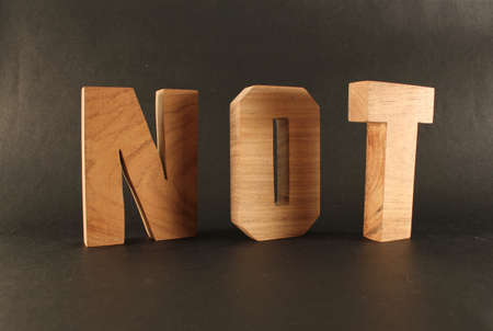naturholz: NOT text from wood letters Holz Buchstaben black Background Stock Photo