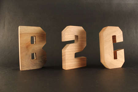 lettre: B2C text from wood letters Holz Buchstaben black Background Stock Photo