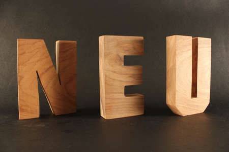 naturholz: Neu text from wood letters Holz Buchstaben black Background