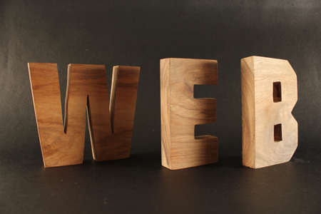 naturholz: WEB text from wood letters Holz Buchstaben black Background