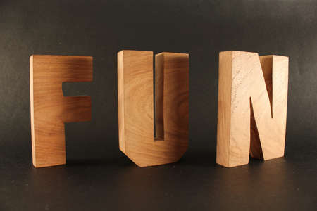 naturholz: Fun text from wood letters Holz Buchstaben black Background