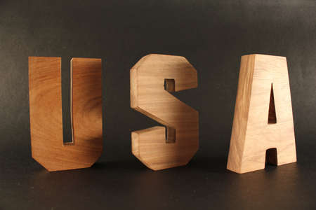buchstabe: USA text from wood letters Holz Buchstaben black Background Stock Photo