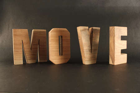 lettre: MOVE text from wood letters Holz Buchstaben black Background