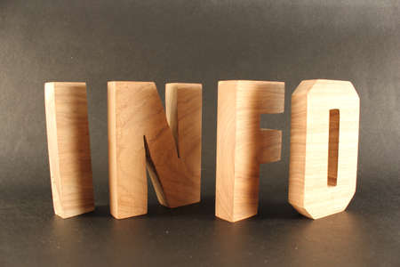 buchstabe: INFO text from wood letters Buchstaben black Background