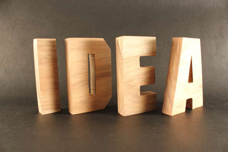 typ:  Idea text from wood letters Holz Buchstaben black Background
